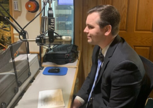 Spiros Law Attorney Jordan Butler at the radio station